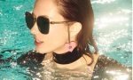 An image from the Gucci eyewear campaign of a model wearing the new sunglasses in a swimming pool