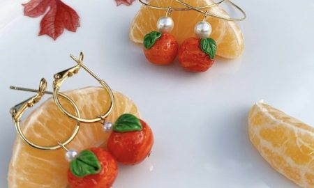 gold hoop earrings with oranges