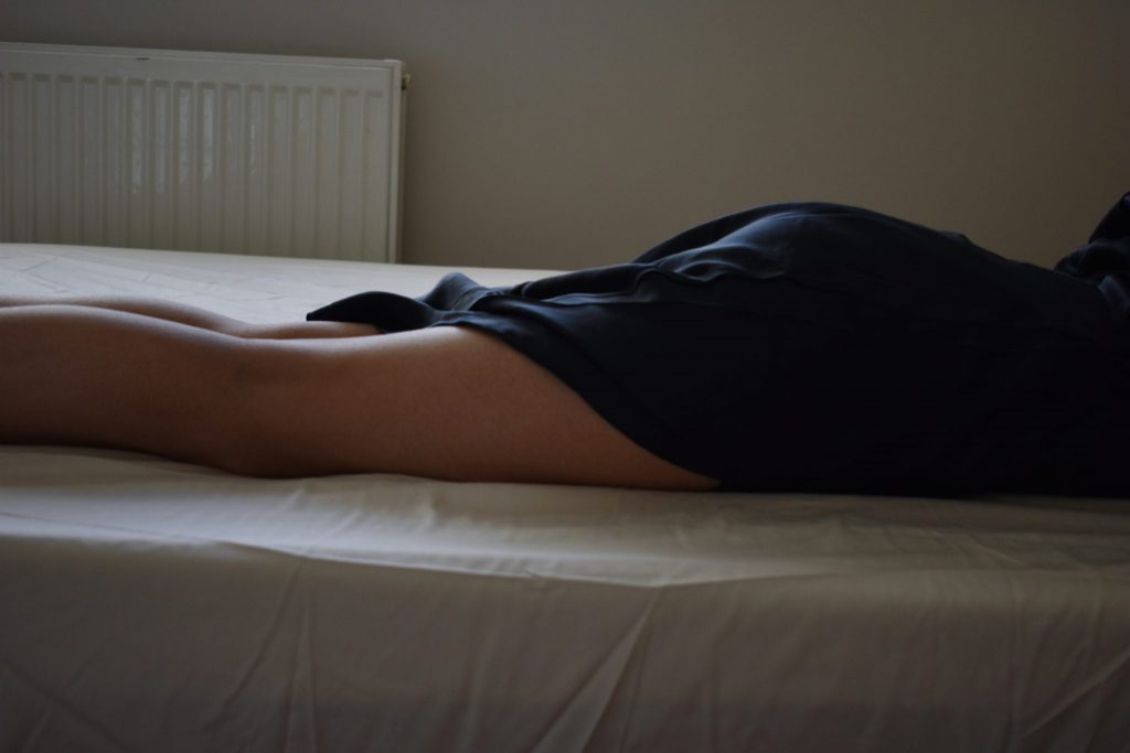 Image of girl with her legs laid out
