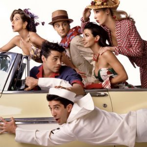 A photoshoot of the characters in a convertible car