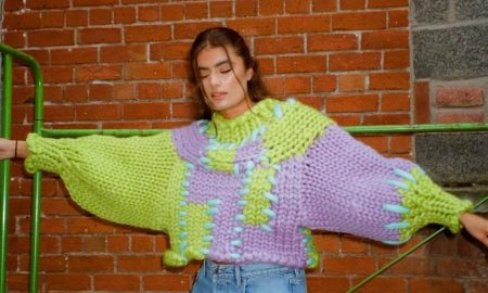 Woman in knit jumper from Hope Macaulay