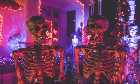 two skeletons at a neon party